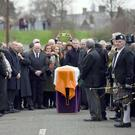 The coffin of Martin McGuinness is surrounded by mourners as his funeral takes place in Derry