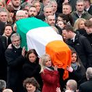 Sinn Fein's Michelle O'Neill (front left), Mary Lou McDonald (middle left) and Gerry Adams, carry the coffin of Northern Ireland's former deputy first minister and ex-IRA commander Martin McGuinness down Westland Street into the Bogside Photo: Chris Radburn/PA Wire