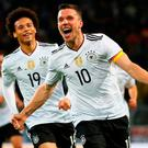 Lukas Podolski of Germany celebrates scoring his sides winner last night