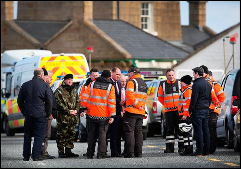 Minister of State at the Departments of An Taoiseach and Defence with Special Responsibility for Defence Paul Kehoe TD and Minister of State for Regional Economic Development Michael Ring TD meet with members of the Irish Coastguard at Blacksod Bay in Co Mayo during the seach and recovery of Rescue 116. Pic Steve Humphreys
