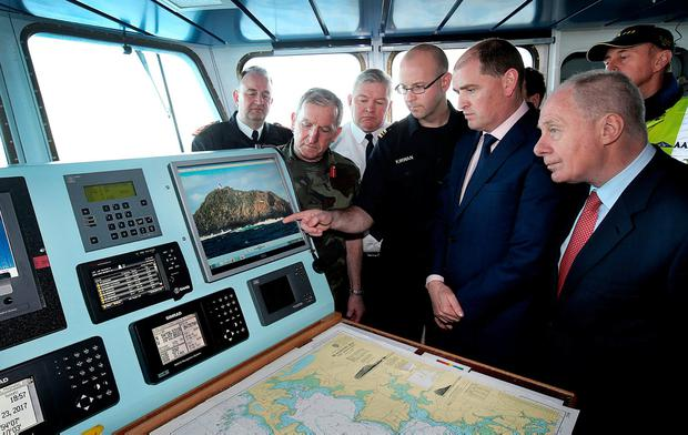 Defence Minister Paul Kehoe and Regional Economic Development Minister and local TD Michael Ring are debriefed from the bridge of the LE Samuel Beckett situated near Blacksod Bay in Co Mayo. Photo: Steve Humphreys