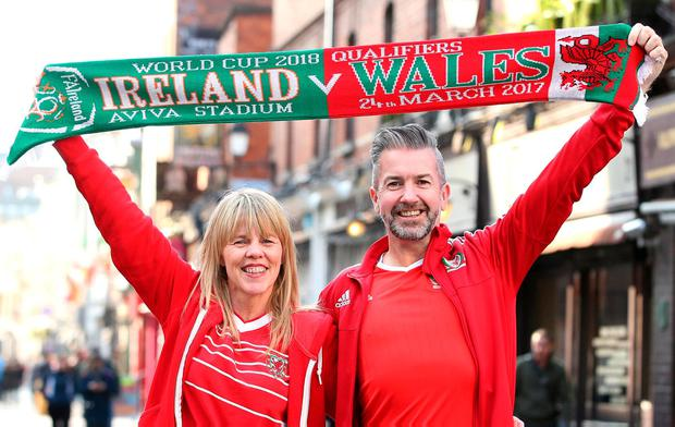 Sharon Edwards and Paul Jones are all set for the big game. Photo: Damien Eagers