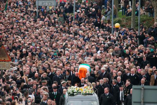 Huge crowds line the route of the funeral cortege. Photo: Gerry Mooney