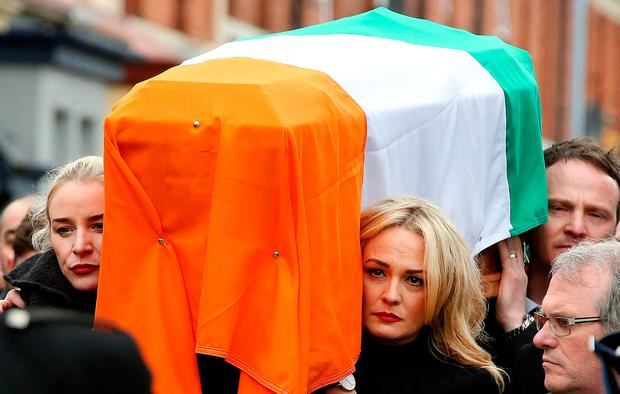 Fionnuala and Gráinne McGuinness carry their father's remains. Photo: Gerry Mooney