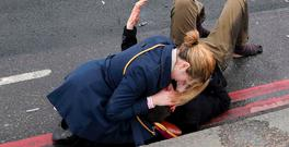 An injured person is assisted on Westminster Bridge after the terror attack. Photo: Reuters/Toby Melville