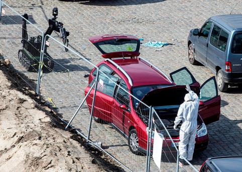 A forensics expert stands next to a car which had entered the main pedestrian shopping street in the city at high speed, in Antwerp, Belgium. Photo: REUTERS
