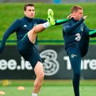 Seamus Coleman and James McCarthy stretch at training ahead of tonight's game against Wales. Photo: Matt Browne/Sportsfile