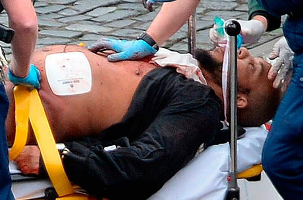 Westminster attacker Khalid Masood receives treatment after being shot during the attack. Photo: Stefan Rousseau/PA Wire