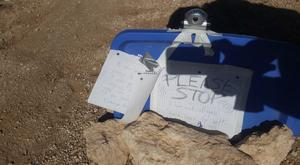 Signs made by Amber VanHecke, who was stranded for five days near the Grand Canyon in Arizona (Arizona Department of Public Safety via AP)