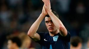 England's Michael Keane applauds fans after England match