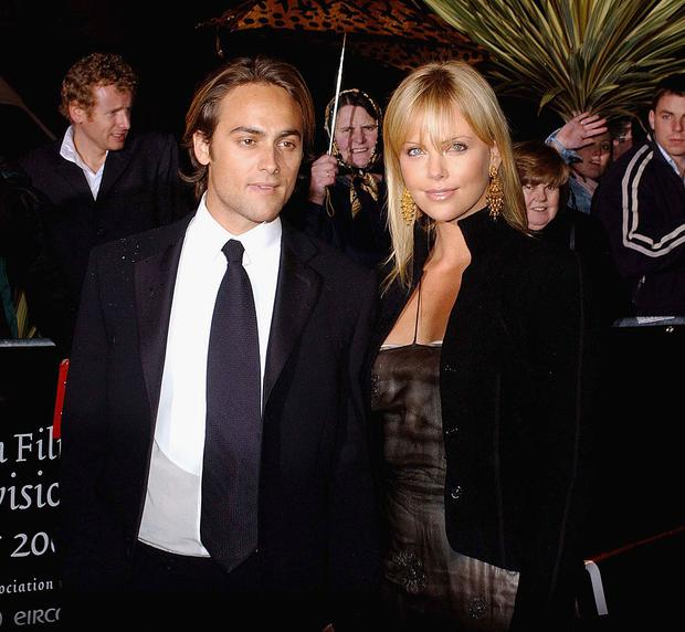 South African actress Charlize Theron and ex boyfriend Stuart Townsend attend the Irish Film and Television Awards at the Burlington Hotel on November 1, 2003 in Dublin, Ireland.
