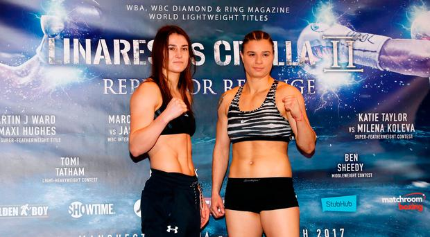 Katie Taylor (left) and Milena Koleva during the weigh-in at the Radisson Edwardian Hotel, Manchester. Martin Rickett/PA Wire