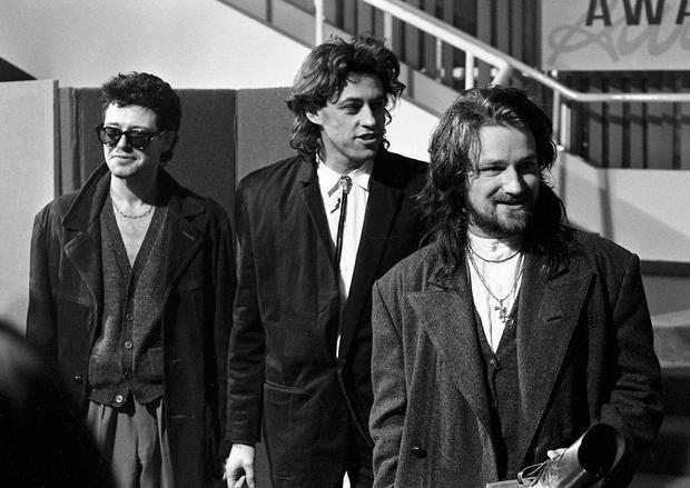 At the Milk Music Awards in the National Concert Hall. Adam Clayton, Bob Geldof (Boomtown Rats), and Bono. U2 won: Best International Group, Best Irish Group, and Best Irish Album for 'The Unforgettable Fire.' Pics by Jim O'Kelly and Michael MacSweeney, 13/3/86. (Part of the NPA and Independent Newspapers Ireland)