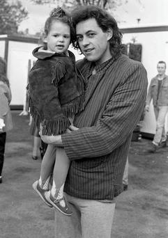 Bob Geldof of The Boomtown Rats with his daughter Fifi Trixibelle Geldof at the Self-Aid benefit concert in the RDS, 17/05/1986 (Part of the Independent Newspapers Ireland/NLI Collection).