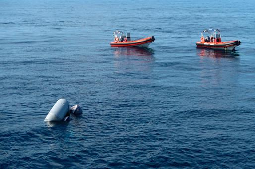 In this photo released by Proactiva Open Arms NGO on Friday, March 24, 2017 a sunken rubber boat in the Mediterranean Sea off the Libyan coast, during a search and rescue operation by Spanish NGO Proactiva Open Arms. (Proactiva Open Arms via AP)