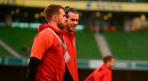 Gareth Bale, right, with Aaron Ramsey of Wales prior the FIFA World Cup Qualifier Group D match between Republic of Ireland and Wales at the Aviva Stadium in Dublin. Photo by Eóin Noonan/Sportsfile