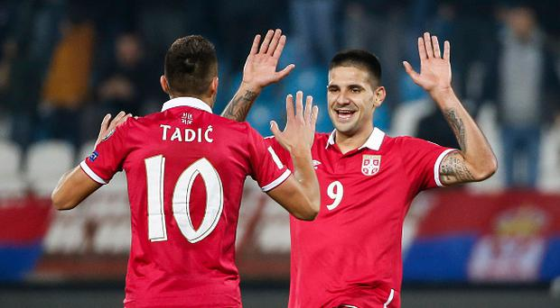 BELGRADE, SERBIA - OCTOBER 09: Aleksandar Mitrovic (R) celebrate scoring a goal with the Dusan Tadic (L) of Serbia during the FIFA 2018 World Cup Qualifier between Serbia and Austria at stadium Rajko Mitic on October 9, 2016 in Belgrade, . (Photo by Srdjan Stevanovic/Getty Images)