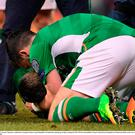 24 March 2017; Seamus Coleman is comforted by teammate Shane Long of Republic of Ireland after picking up an injury during the FIFA World Cup Qualifier Group D match between Republic of Ireland and Wales at the Aviva Stadium in Dublin. Photo by Brendan Moran/Sportsfile