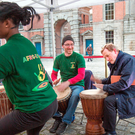 Taoiseach Enda Kenny plays the bongos with the Afro-Éire group at the launch of RTÉ's Cruinniú na Cásca at Dublin Castle this week. Photo: Tony Gavin