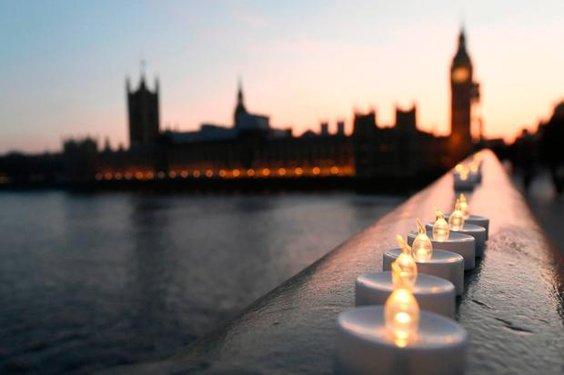 Candle lights on Westminster Bridge, where the terror attack took place. Photo: AP