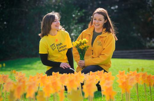 Katie Boyle, from Sligo, and Aoife McDarby, from Ranelagh, during Daffodil Day in the Garden of Hope at Iveagh Gardens, Dublin Photo: Collins