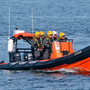 A Coast Guard boat searches the coastline around Blacksod Picture: Collins