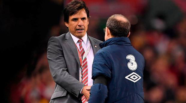 Wales manager Chris Coleman shakes hands with Republic of Ireland manager Martin O'Neill, right, after the FIFA World Cup Qualifier Group D match between Republic of Ireland and Wales at the Aviva Stadium in Dublin. Photo by Brendan Moran/Sportsfile