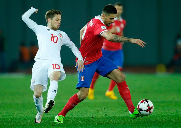 Georgia's Jano Ananidze in action against Serbia's Aleksandar Mitrovic. Photo: Reuters