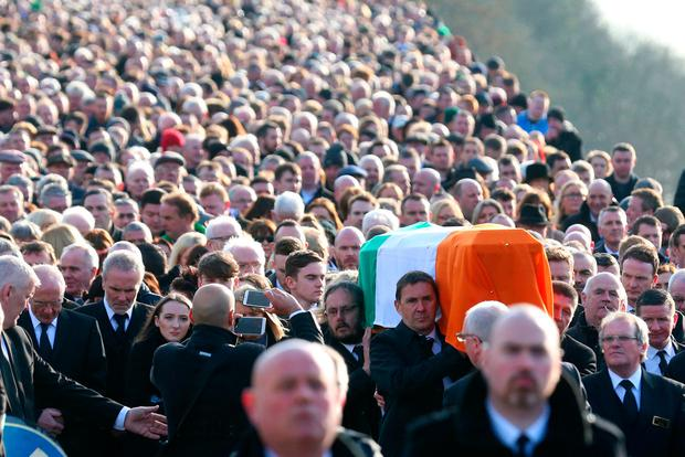 The coffin of Martin McGuinness is carried to the cemetery (AP Photo/Peter Morrison)