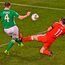 Ireland's John O'Shea is hit by a late tackle from Wales' Gareth Bale. Photo: Sportsfile