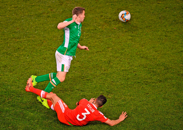Seamus Coleman is tackled late and high by Wales' Neil Taylor, leaving the Ireland captain with a broken leg and earning the Wales defender a red card. Photo: Sportsfile