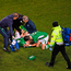 Seamus Coleman is consoled by Shane Long as he is attended to following a horror tackle from Wales' Neil Taylor. Photo: Sportsfile