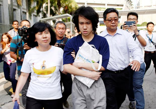 Teen blogger Amos Yee leaves with his parents after his sentencing from the State Court in Singapore July 6, 2015. REUTERS/Edgar Su/File Photo
