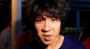 Singapore teen blogger Amos Yee speaks to reporters in 2015 (AP Photo/Wong Maye-E, File)