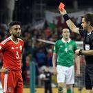 Wales' defender Neil Taylor (L) is shown a red card by Italian referee Nicola Rizzoli during the World Cup 2018 qualification football match between Republic of Ireland and Wales at Aviva Stadium in Dublin, Ireland on March 24, 2017. The game ended 0-0. / AFP PHOTO / Paul FAITH