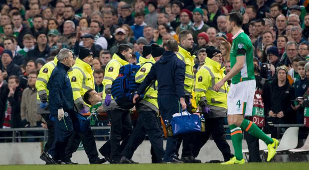 Seamus Coleman of Ireland injured leaves the pitch on the stretcher during the 2018 FIFA World Cup Qualifying Round Group D match between Republic of Ireland and Wales at Aviva Stadium in Dublin on March 24, 2017 (Photo by Andrew Surma/NurPhoto via Getty Images)