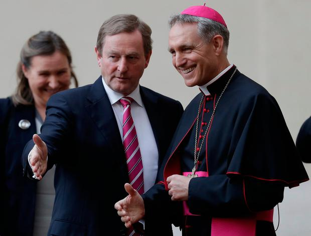 Taoiseach Enda Kenny is welcomed by Prefect of the Pontifical household Georg Gänswein as he arrives at the Vatican for a meeting with Pope Francis, Friday, March 24, 2017. (AP Photo/Alessandra Tarantino)