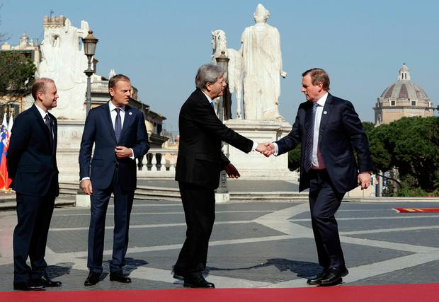 From left, Malta's Prime Minister Joseph Muscat, European Council President Donald Tusk, Italian Prime Minister Paolo Gentiloni and TaoiseachEnda Kenny during arrivals for an EU summit at the Palazzo dei Conservatori in Rome on Saturday, March 25, 2017. (AP Photo/Andrew Medichini)