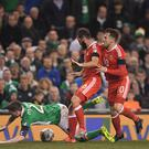 Dublin , Ireland - 24 March 2017; Seamus Coleman of Republic of Ireland is tackled by Joe Ledley and Aaron Ramsey, right, of Wales during FIFA World Cup Qualifier Group D match between Republic of Ireland and Wales at the Aviva Stadium in Dublin. (Photo By Brendan Moran/Sportsfile via Getty Images)