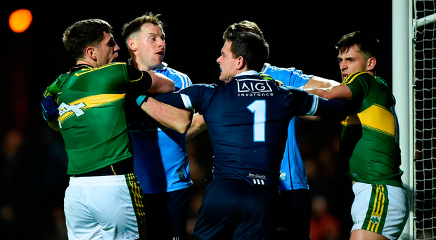 Paul Geaney, left, and Jack Savage of Kerry tussle off the ball with Philip McMahon, Michael Fitzsimons and Stephen Cluxton of Dublin. Photo: Sportsfile