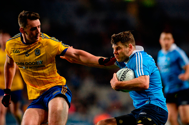 Kevin McManamon of Dublin in action against John McManus of Roscommon. Photo: Sportsfile