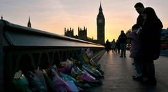 Attacks: Flowers placed on Westminster Bridge, London, after the terrorist incident last Wednesday Photo: Victoria Jones/PA