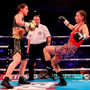 Katie Taylor, left, trades punches with Milena Koleva during their Manchester Fight Night super featherweight bout. Photo by Lawrence Lustig/Sportsfile