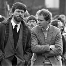 CONTROVERSIAL: Gerry Adams with Martin McGuinness, right, in 1987, at the funeral of Patrick Kelly (30), the reputed IRA commander in east Tyrone Picture: PA