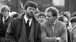CONTROVERSIAL: Gerry Adams with Martin McGuinness, right, in 1987, at the funeral of a reputed IRA commander in east Tyrone Picture: PA