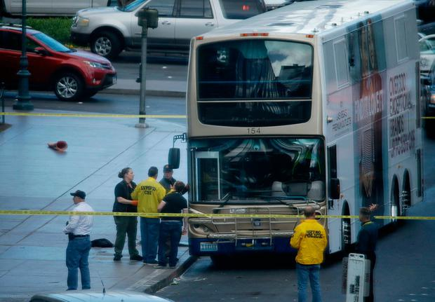 Las Vegas police investigate the scene of a stand-off in a bus along Las Vegas Boulevard, Saturday, March 25, 2017, in Las Vegas. (AP Photo/John Locher)