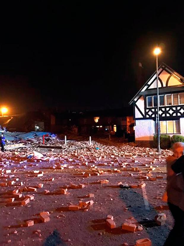Photo taken with permission from the twitter feed of @LewHopkins of the scene of the suspected gas explosion in Bebington, on the Wirral, where a building collapsed. The building, thought to have been a dance studio, was destroyed. Lew Hopkins/PA Wire
