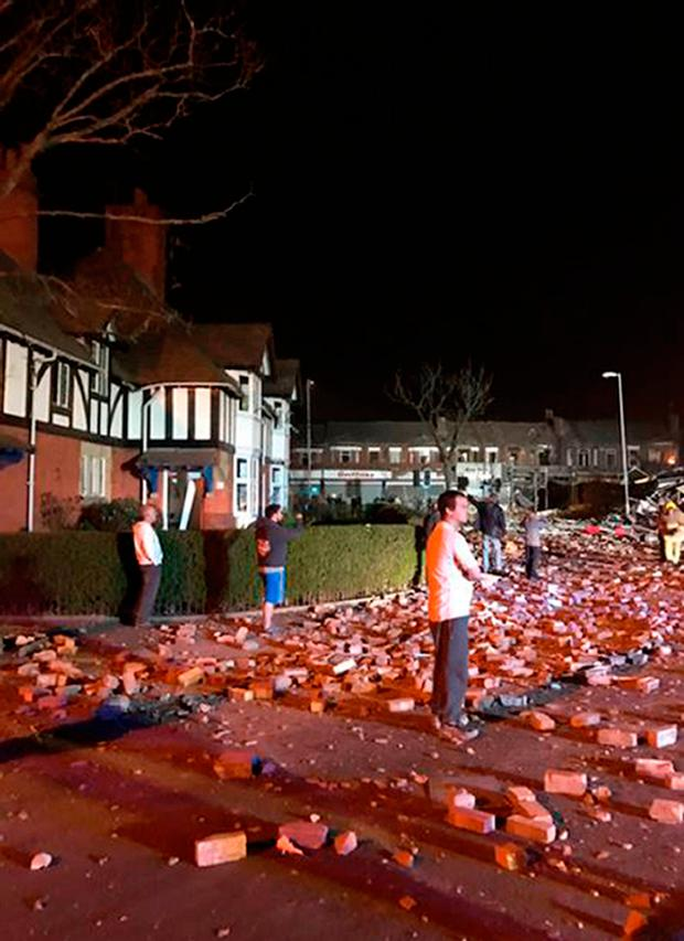 Photo taken with permission from the twitter feed of @LewHopkins of the scene of the suspected gas explosion in Bebington, on the Wirral, where a building collapsed. Lew Hopkins/PA Wire
