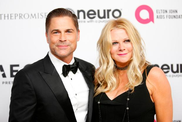 Actor Rob Lowe (L) and wife Sheryl Berkoff pose at Elton John's 70th Birthday and 50-Year Songwriting Partnership with Bernie Taupin benefiting the Elton John AIDS Foundation and the UCLA Hammer Museum at RED Studios Hollywood in Los Angeles, March 25, 2017. REUTERS/Danny Moloshok
