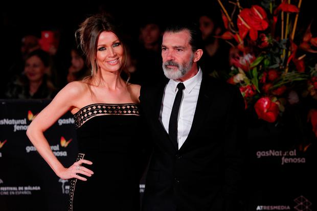 Spanish actor and director Antonio Banderas and his girlfriend Nicole Kimpel pose after their arrival at the closing ceremony of the 20th Festival de Malaga Cine Espanol (Malaga Spanish Film Festival) outside the Cervantes Theatre in Malaga, southern Spain, March 25, 2017. REUTERS/Jon Nazca